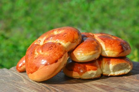 Homemade buns on a table in the garden Stock Photo