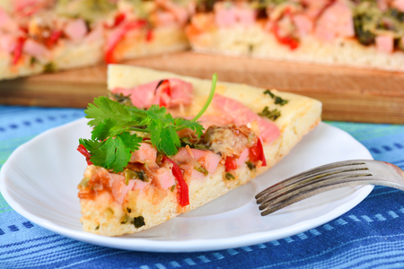 Piece of homemade pizza on a plate Stock Photo