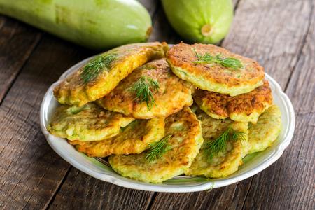 Zucchini pancakes on plate Foto de archivo