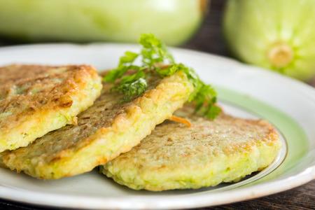 Zucchini pancakes on plate Stock Photo