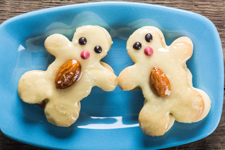 Cookies in the form of funny characters on plate