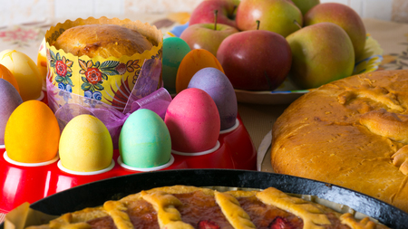 Colorful festive easter eggs and easter sweet baking