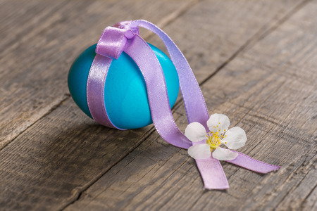 Colorful festive easter egg, tied with a ribbon