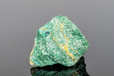 Fuchsite mineral  on gray background
