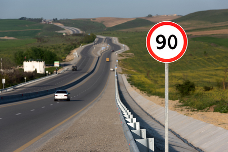 Speed limit 90, road sign on highway