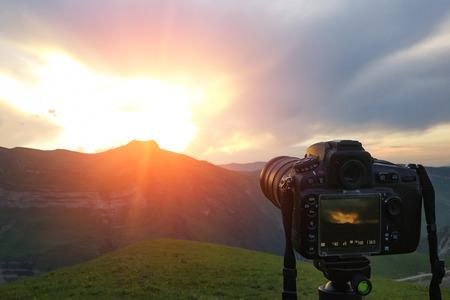 Camera on a tripod, shooting mountains scenery