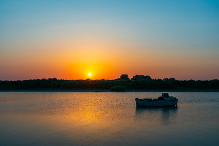 Amazing beautiful sunset on the river Foto de archivo
