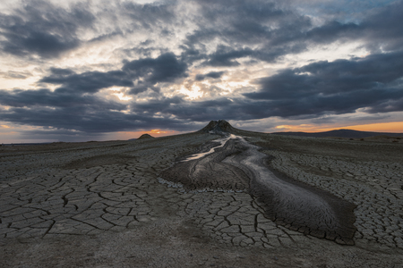 Mud volcanoes at sunset,  amazing natural phenomenon