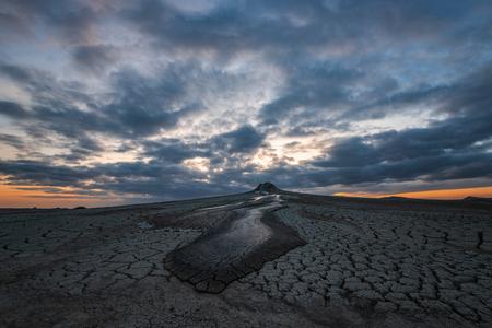 Mud volcano at sunset,  amazing natural phenomenon