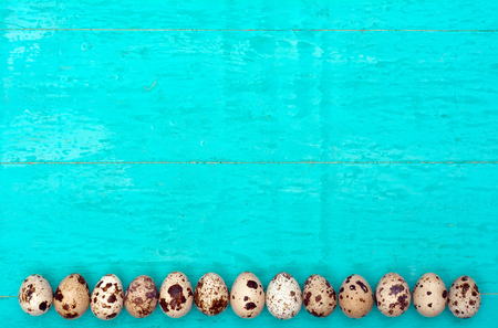 Quail eggs on wooden background Zdjęcie Seryjne