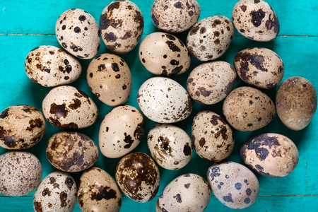 Quail eggs on wooden background Stock Photo