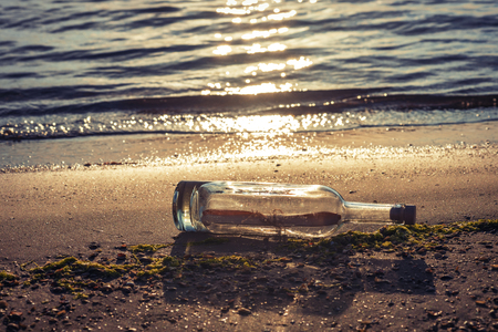 Message in a corked bottle on the shore, hope of salvation Banco de Imagens
