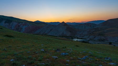 Amazing mountain landscape with lake at sunset