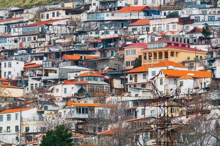 Many private houses on mountain slope