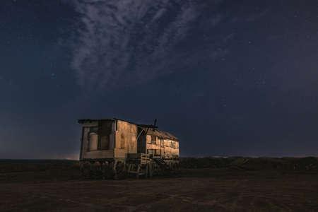 Old fishing hut in the night