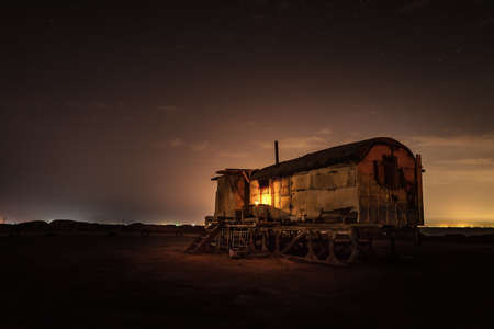 Old fishing hut in the night