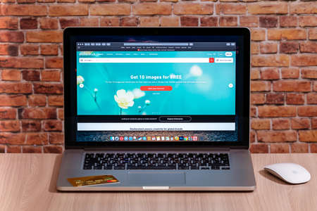 Estonia, Tallinn, July 11, 2020. Search for photos on Shutterstock site on Apple Macbook Pro
