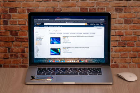 Estonia, Tallinn, July 11, 2020. Search for goods on Amazon site with Apple Macbook Pro