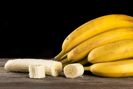 Ripe bananas on a wooden table