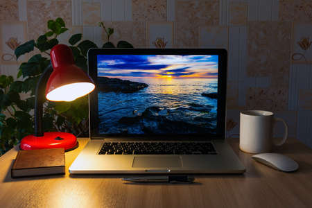 Laptop on the table, freelancer workplace