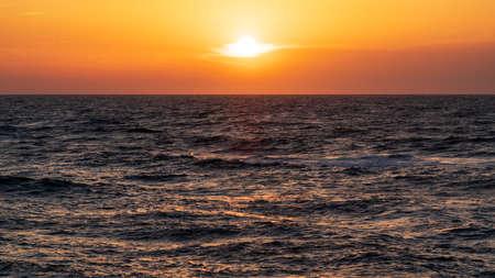 Dark dramatic sunset over the sea 版權商用圖片