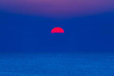 Colorful sun rise at sea