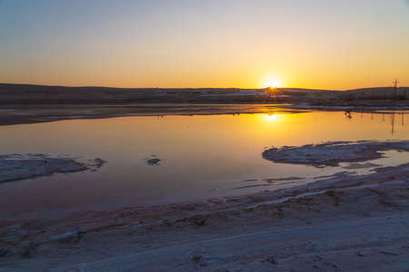 Dried up salt lake at sunrise