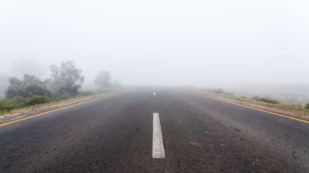 Empty highway road in foggy weather