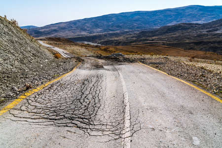 Destroyed asphalt road, earthquake consequences