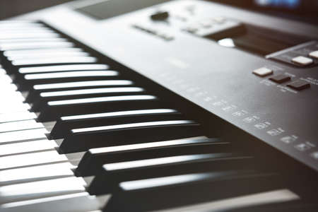 Electronic piano keyboard for playing and recording music in studio