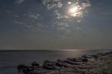 Seashore on a moonlit night