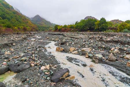 Mountain river bed in autumn season