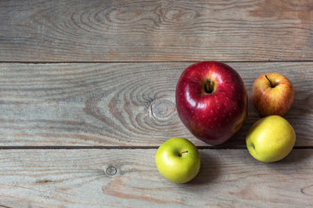 Big red apple on wooden table
