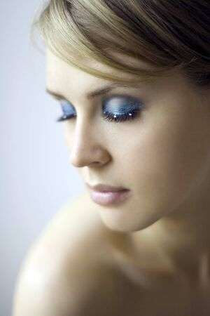 Portrait of the beautiful young woman with closed eyes.  photo