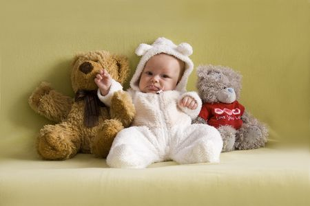 Portrait of the baby girl in Teddy bear costume. photo