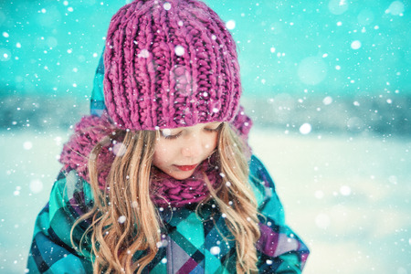warm clothes: Colorful winter portrait of a pretty little girl Stock Photo