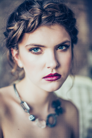 Beautiful young woman. Professional make-up and hairstyle. Perfect skin. Fashion photo. Archivio Fotografico