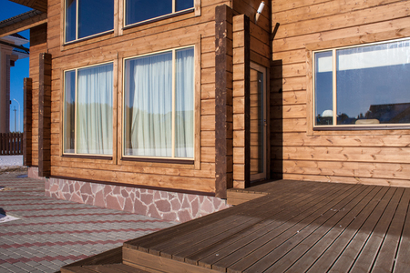 Terrace of a new wooden house. Stock Photo