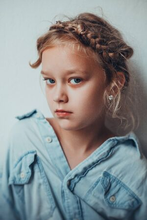 Portrait of 8 years old russian girl with braid hairdo. Casual style. Stok Fotoğraf