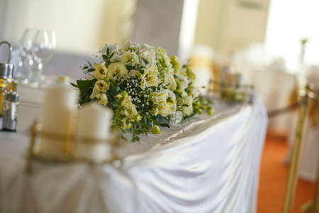 White and green bouquet on a stone parapet with rose, eustoma, chrysanthemum and dahlia. Horizontal closeup image Stock fotó