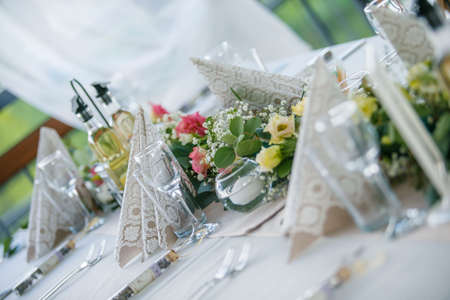 Fresh flowers in a wedding decoration. Night Banquet