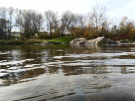 par: Beautiful River ripple in Elma Manitoba, with rocks to par