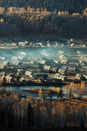 Landscape of a village in autumn photo