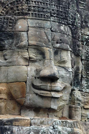Giant ancient buddha rock statue at Angkor Cambodia photo