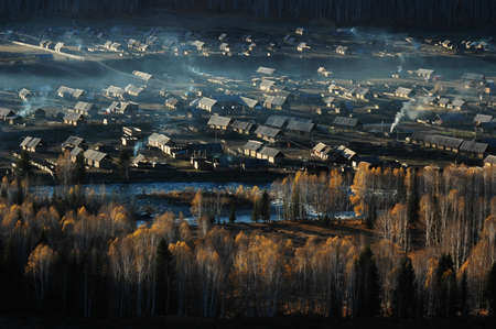 Landscape of a small village and woods in an autumn morning Stock Photo - 8518746