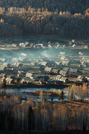 Landscape of a small village and woods in an autumn morning Stock Photo - 8518822