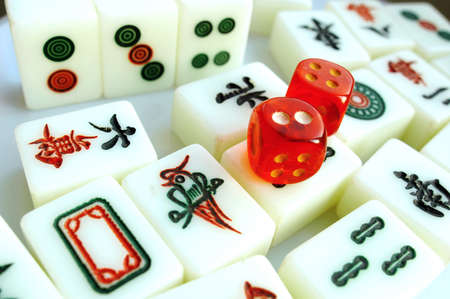 Closeup view of the most popular entertainment mahjong pieces with dices in China photo
