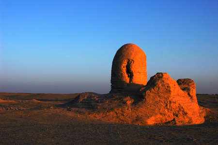 relics: Relics of an ancient castle named Milan in the desert of Sinkiang at sunrise Stock Photo