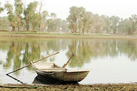 Scenery of a wooden boat at a lake photo