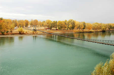 Scenery of a drawbridge over the river in an early autumn morning Stock Photo - 8575802